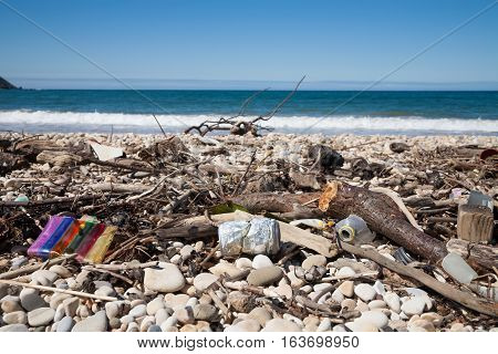 Metal Can And Waste In Beach