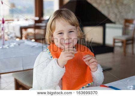 Portrait Cute Baby Eating In Restaurant