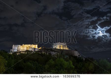 Full moon over Acropolis of Athens through the clouds Greece