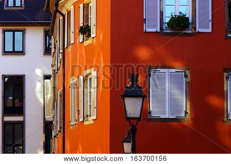 Red House Wall With Beautiful Windows And Shutters