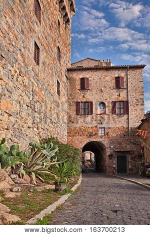 Bolsena, Viterbo, Lazio, Italy: the ancient alley that skirts the castle and the entrance underpass in the old town