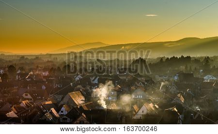 Aerial View To Obernai And Silhouettes Of Montains On Horizon