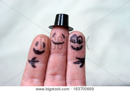 A group of finger puppets come in for a group hug.