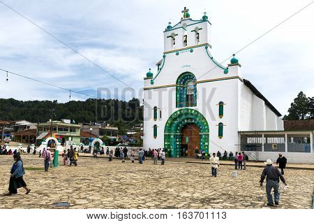 San Juan Chamula - May 11 2014: Local people in front of the Church of San Juan in the town of San Juan Chamula Chiapas Mexico