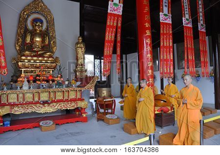 NANJING, CHINA - JUL.10, 2012: Gilt-Bronze Statue of Vairocana Buddha in Pilu Temple, Nanjing, Jiangsu Province, China. Pilu Temple was built in 1522, and is one of the most antique temples in Nanjing