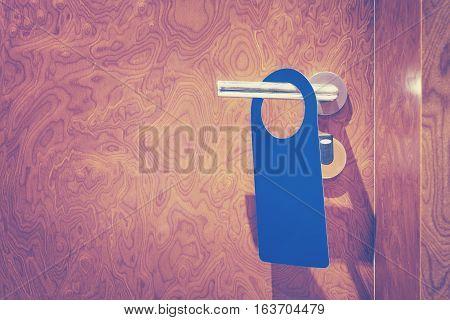 Hotel Room Closed Door With Hanger, Copy Space