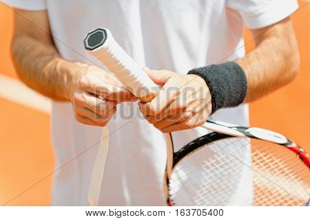 Putting New Grip Tape On Tennis Racket