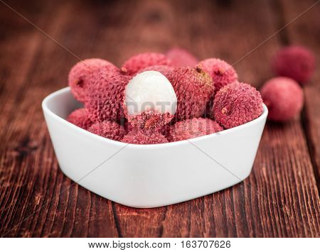 Portion Of Lichee Fruits On Wooden Background (selective Focus)