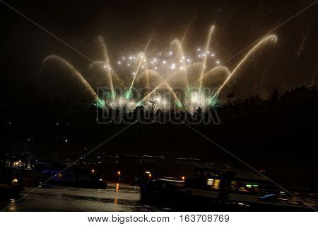 Famous Fireworks Next To River With Boats