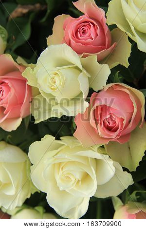 White and pink roses in a floral wedding arrangement
