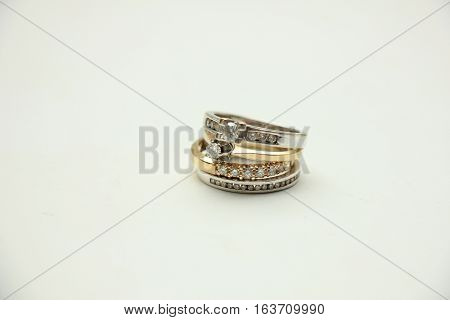 Two wedding sets one in yellow gold one in white gold for a double bride wedding