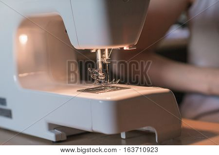 Sewing machine and sewing accessories on wooden table