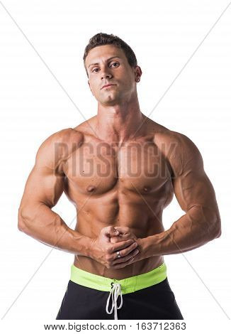 Handsome shirtless bodybuilder looking at camera, isolated on white background