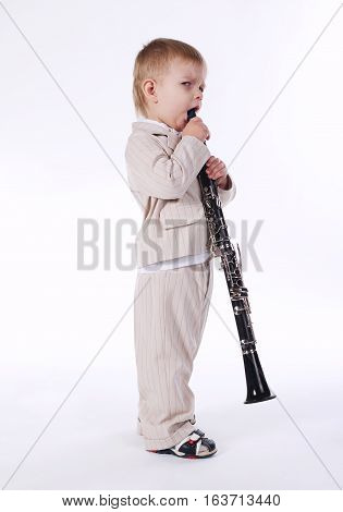 photo of little beautiful boy with clarinet isolated