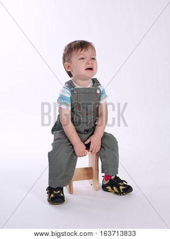 photo of cute little crying boy on white
