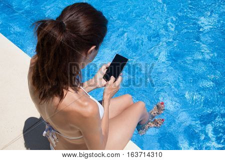Aerial View Of Woman Using Phone Screen Water Pool Behind