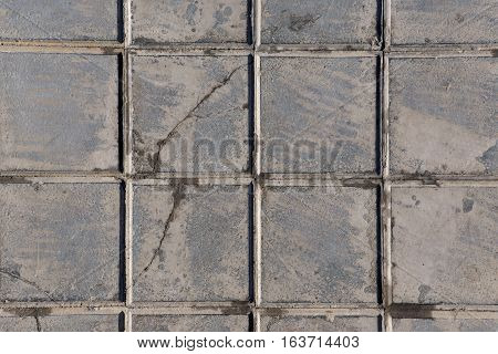 concrete tile for outdoor use Sidewalks, non-slip and wear resistance paving with tile Dirty and broken hydraulic tiles, top view