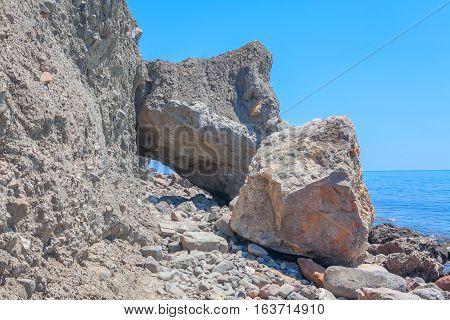 seaside covered by big rocks after landslip