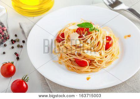 Pasta with Parmesan tomato sauce. Traditional Italian spaghetti with Parmigiano-Reggiano.