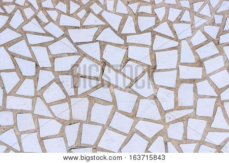 Pattern of broken white tiles, brittle, mosaic, trencadis breakable, front view, enamelled ceramics glazed