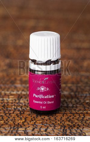VILNIUS, LITHUANIA - 02 JANUARY,  2017: Bottle of Young Living PURIFICATION essential oil blend. One of the most popular brands of essential oils in the world.