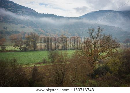 Scenic Foggy Autumn Landscape In Vouraikos Gorge Near Railway, Greece