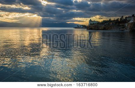 Urban Landscape With Clouds And Reflections  In Loutra Edipsou, Evia