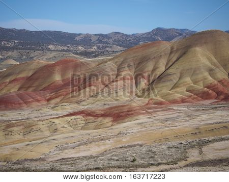 The steep of the colored Painted Hills in the John Day Fossil Beds in Eastern Oregon on a sunny Spring Day.