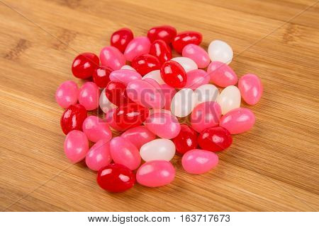 Valentine Colored Jelly Beans Isolated On A Wood Background