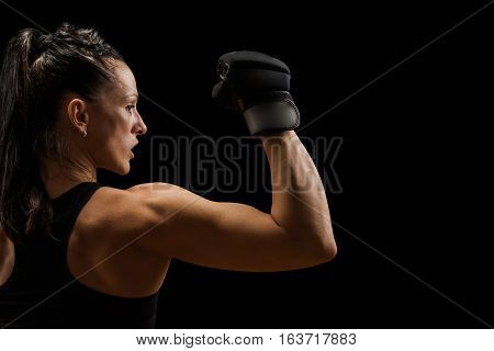 Fitness woman with the black boxing gloves. Attractive Female Boxer Training.
