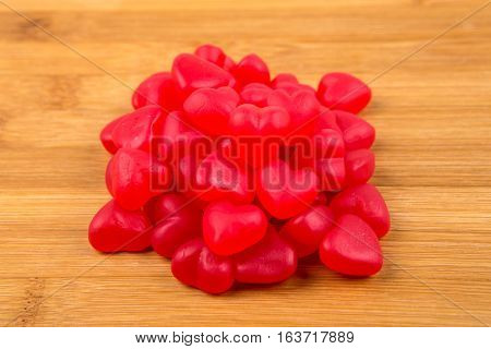 Heart Shaped Gummy Candy Isolated On A Wood Background