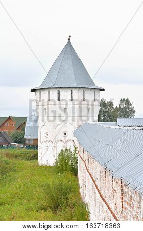 Fortress wall of of Saviour Priluki Monastery by cloud day near Vologda Russia.