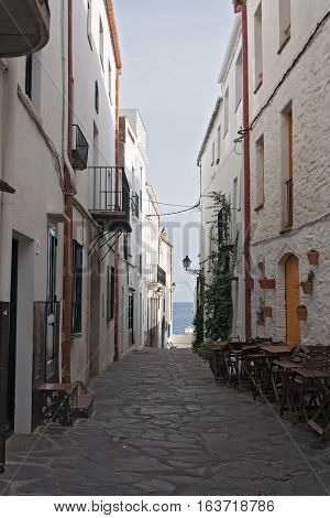 Narrow street in historical center of Cadaques, Cataluya, Spain