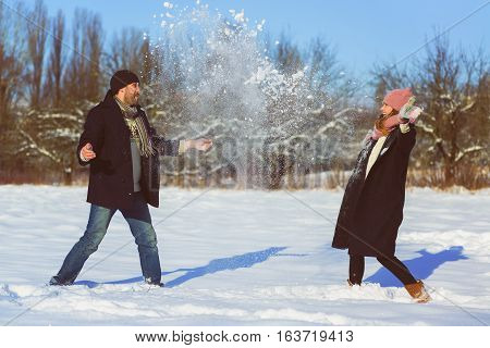 Happy man and woman. Young Couple On Winter Vacation.