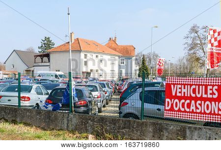 STRASBOURG FRANCE - MAR 20 2016: Vehicules d'Occasion translating as Used Cars garage outside the city of Strasbourg with large selection of French and German cars - Renault Peugeot Citroen Vw Ford