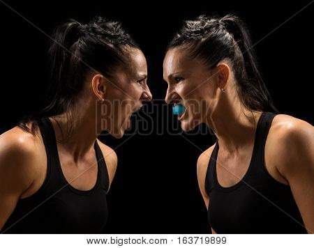 Two women fight. Angry women looking at each other with hatred. You vs. you concept.