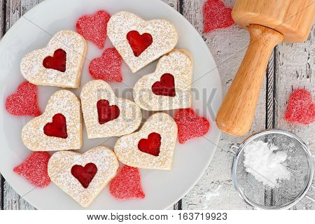 Heart Shaped Valentines Day Cookies With Jam And Candies, Overhead Scene On White Wood