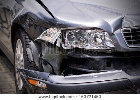 Car crash accident on street damaged cars after collision. Selective focus point on Headlight lamp car.