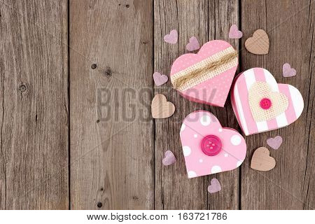 Valentines Day Heart Shaped Gift Boxes With Soft Pink And Burlap Trim In A Cluster Over Wood