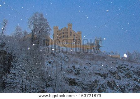 Fussen Germany - December 26 2014: view of Hohenschwangau Castle in Bavarian Alps in winter time on December 26 2014 near Fussen Germany.
