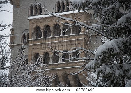 Fussen Germany - December 26 2014: view of the fragment of Neuschwanstein Castle between tress in winter time on December 26 2014 near Fussen Germany.
