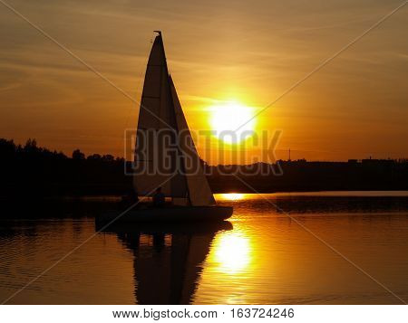 sailboat on the lake sunset landscape. copy space