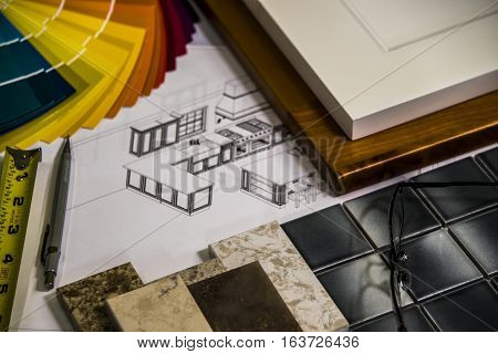 A beautiful interior design of a custom kitchen with material selection of kitchen doors, floor tiles, kitchen counter tops and wall painting color samples