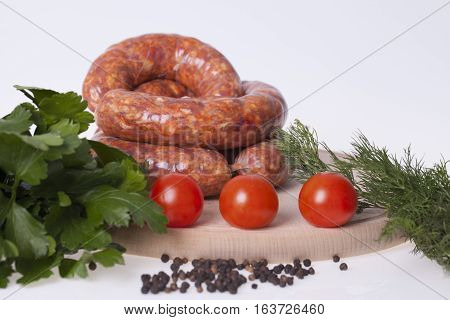 raw homemade sausages with vegetable and spices on the table