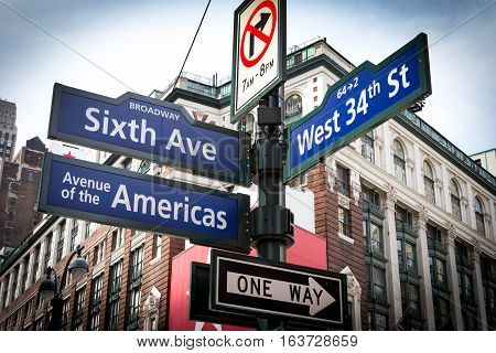 Intersection signs of Broadway Sixth Avenue and West 34th Street near Herald Square in Midtown Manhattan New York City NYC
