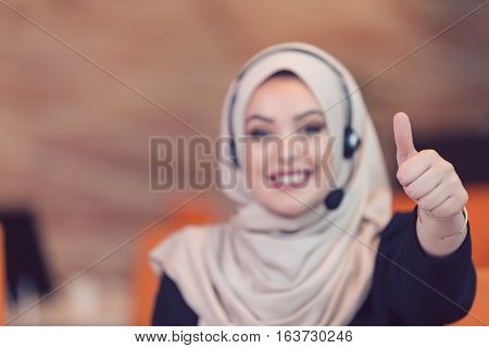 Beautiful phone operator arab woman working isolated on a white background