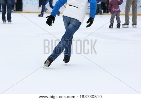 the people skating on the ice rink
