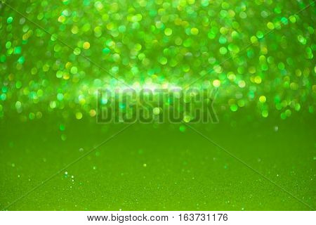 Defocused Abstract Green Glitter With Bokeh Background