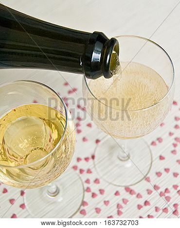 champagne champagne poured into glass two glasses