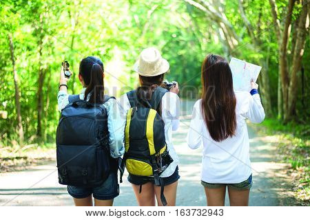Group of beautiful young women walking in the forest enjoying vacation travel concept